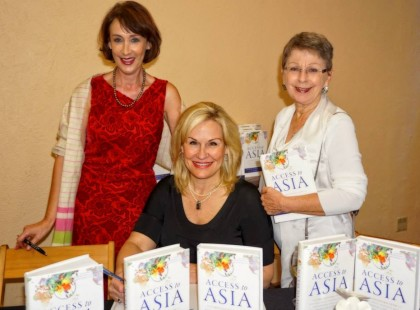Author Sharon Schweitzer with me (in red) and Joan Marie Grable at a recent book signing event.